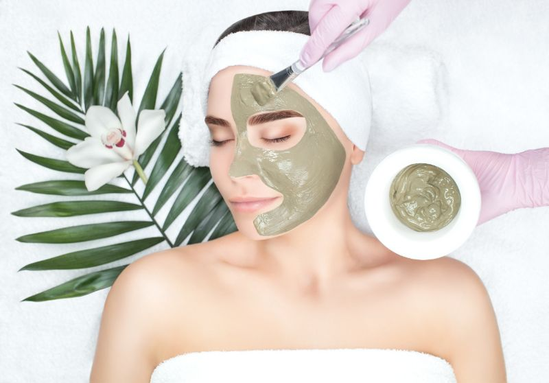 Woman getting a facial with mask