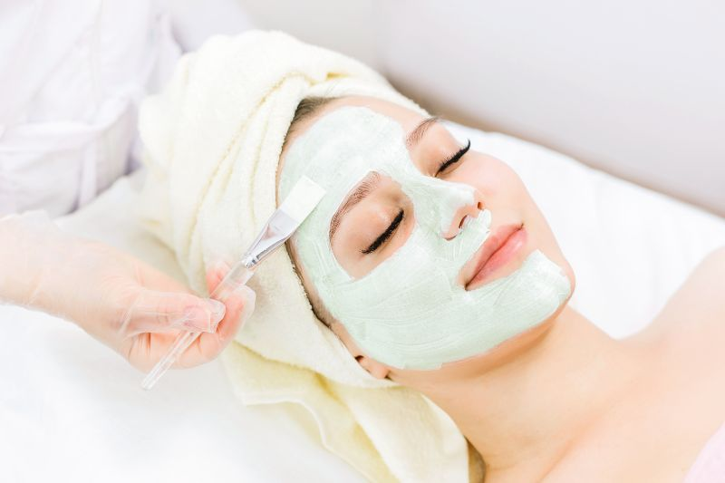 Lady getting spa treatment at beauty salon.